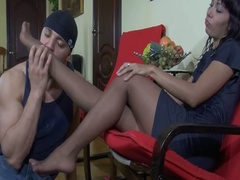 Naughty asian in pantyhose gives up a footjob and a fuck