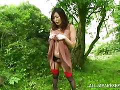 Nature loving Nippon cutie is receiving her dose of wilderness! This cute slut has her hands tied on a tree branch and gets roughly drilled from behind. Her groans and screams won't aid her 'coz there's nobody around. Look at that ravishing wet crack being rubbed with a fake penis and then drilled hard.