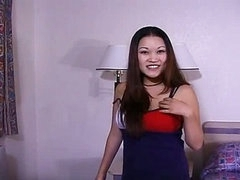 Asian playgirl milking a hard penis